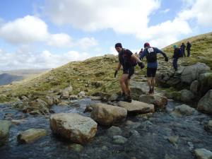 Matt shows Carl the best way to cross a beck at Angle Tarn...facing forwards hehe